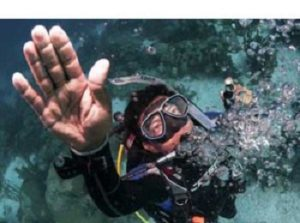 Scuba diver doing controlled emergency slow ascent